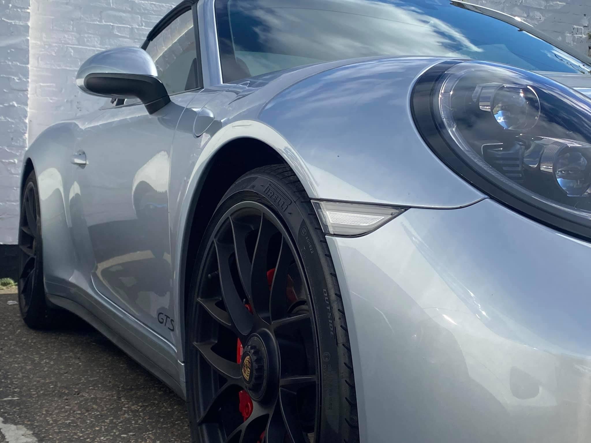 Porsche with black alloys